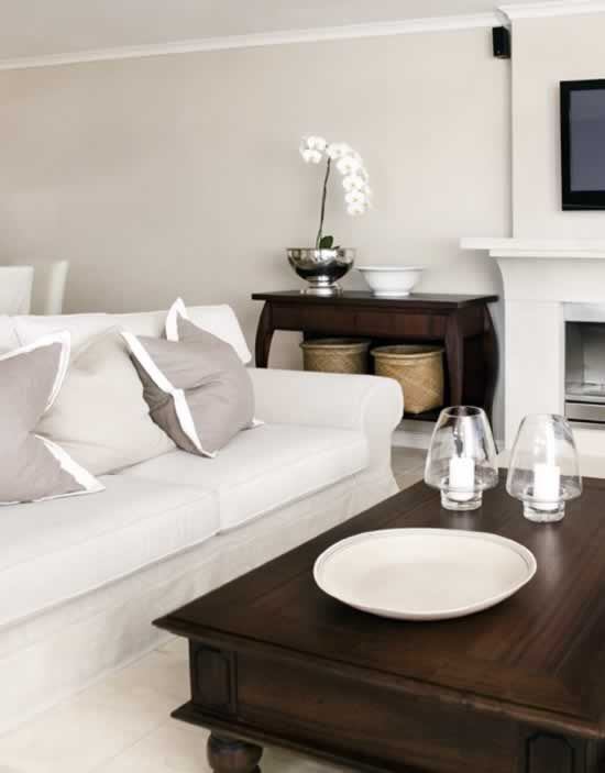 Beautiful Chic Living Room...love the contrast with the clean + crisp white + greige in contrast to the dark walnut woods