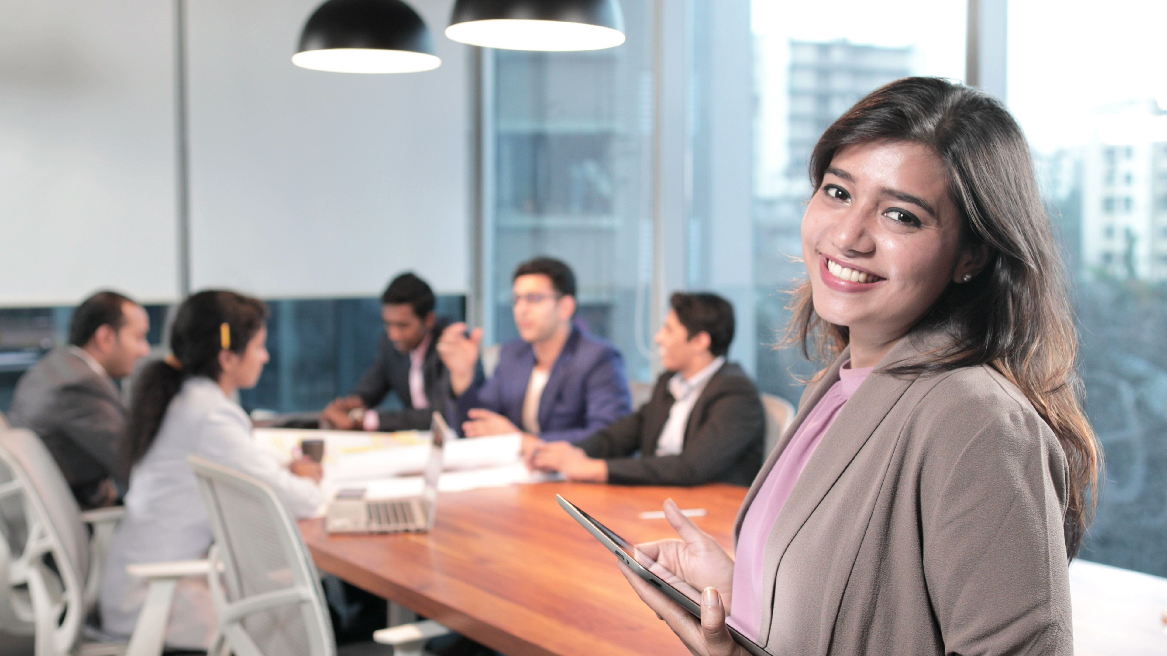 A beautiful office employee smiling at modern corporate