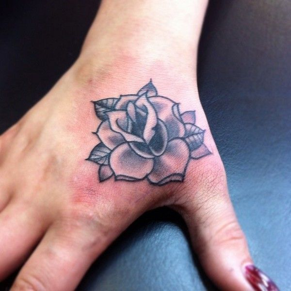30 Delicate Flower Tattoo Ideas Single Rose Tattoos Rose Hand Tattoo Hand Tattoos For Women
