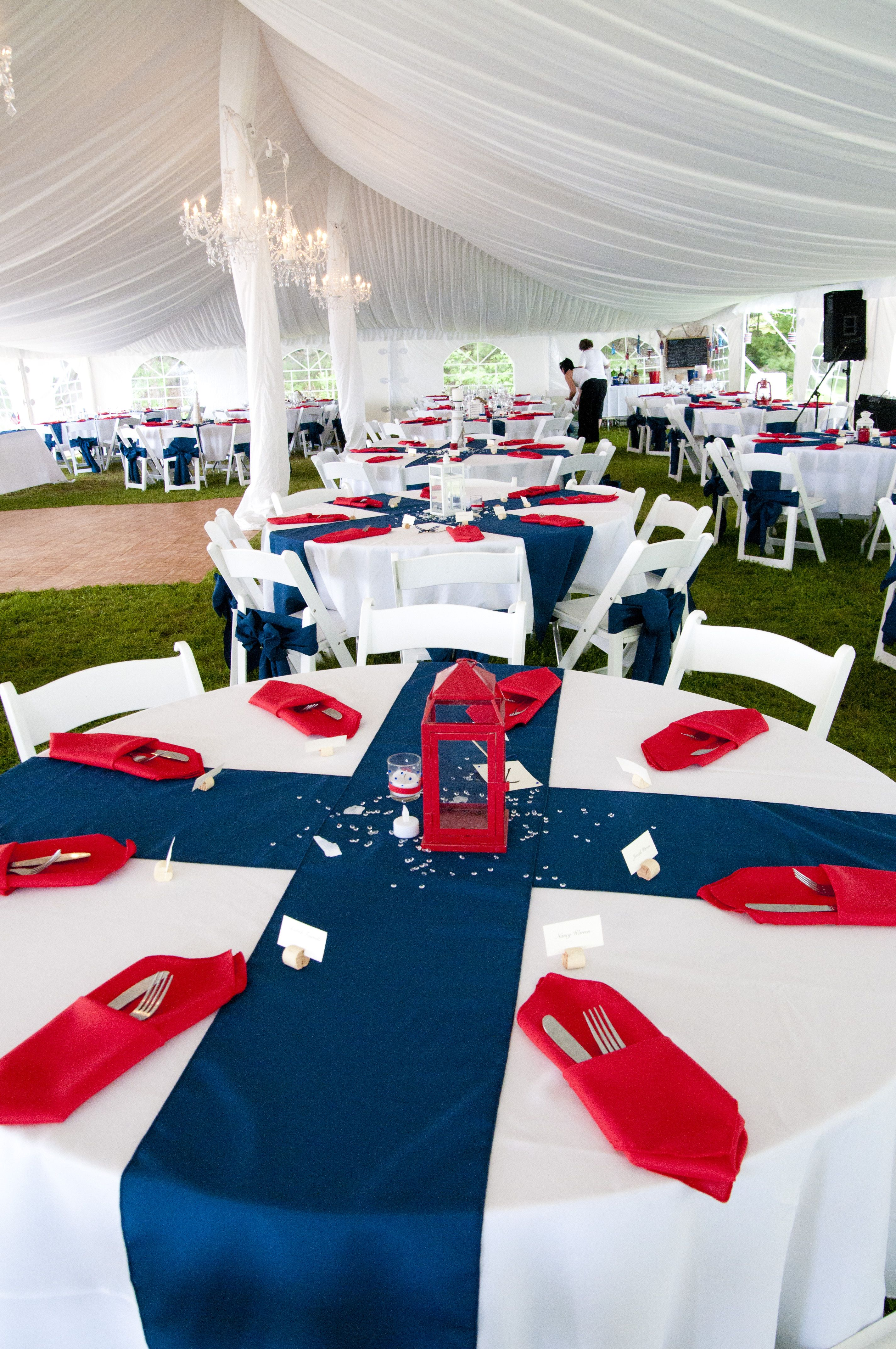 white table cloths, blue table runners, red napkins. A
