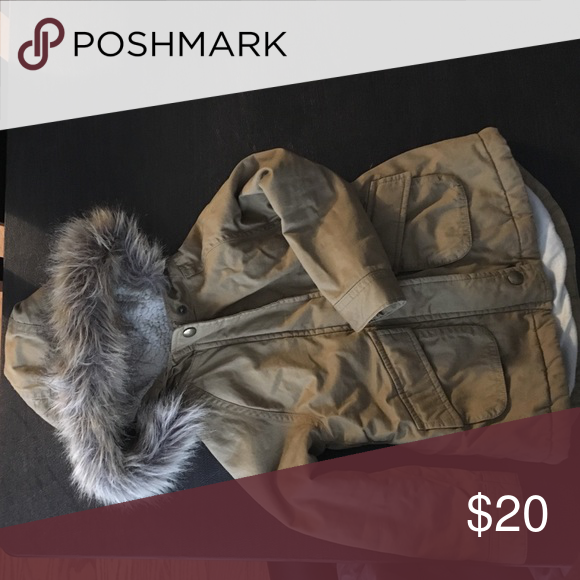 Faux fur parka Beige hidden zip closure, three button snap closure built in hood with soft faux Sherpa lining and faux fur trim, flap slant pockets in front, soft medium weight twill Jackets & Coats