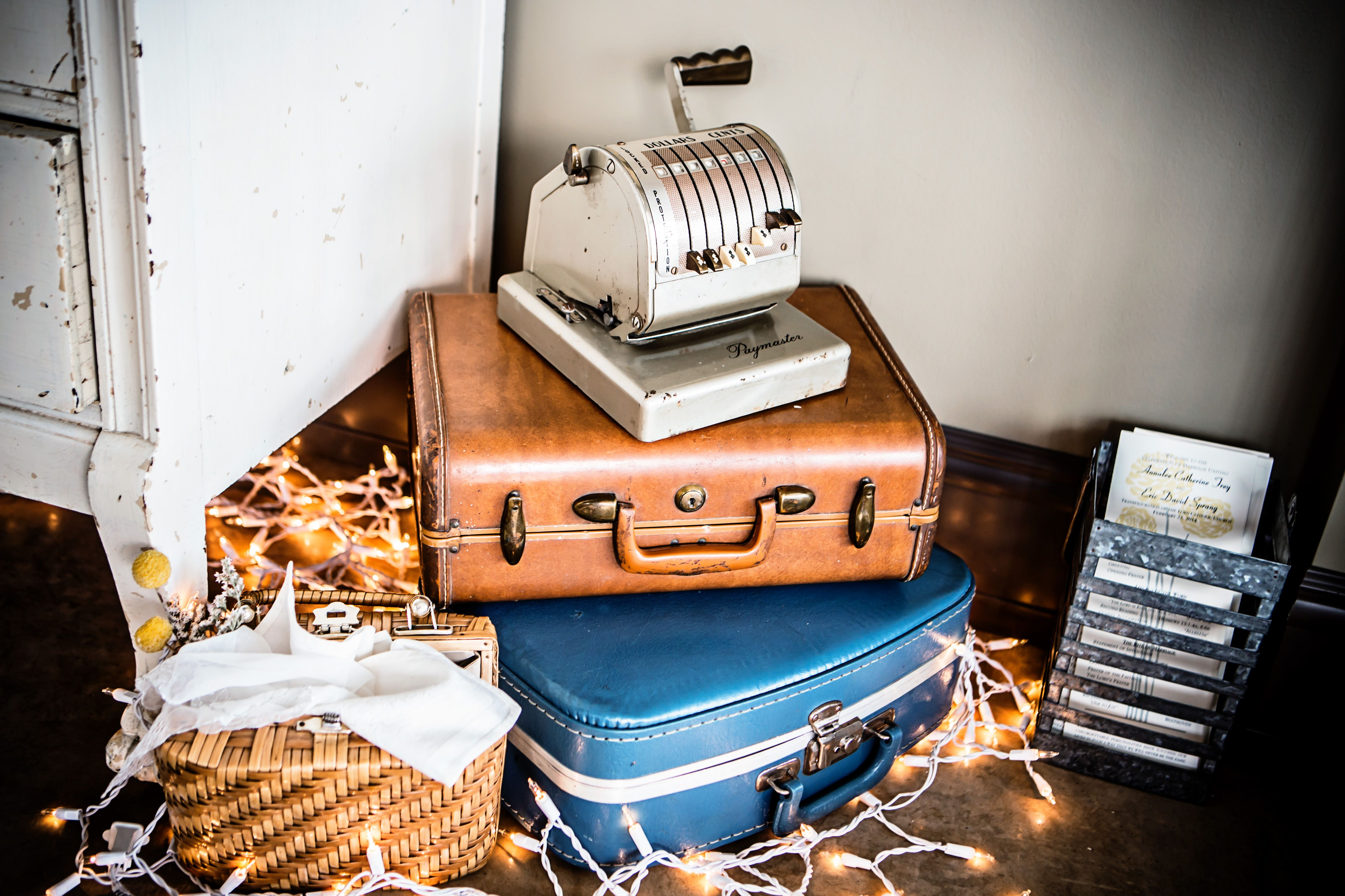 vintage suitcases for wedding reception entry way. Photo courtesy of Ben Barnes Photography