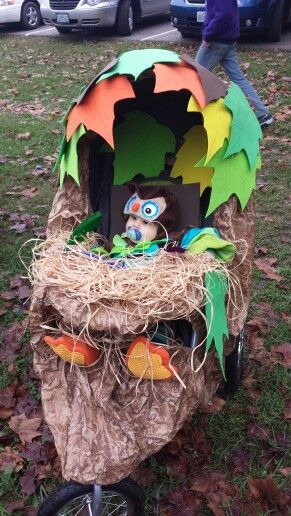 Halloween Decorated Baby Stroller As An Owl Nest Baby