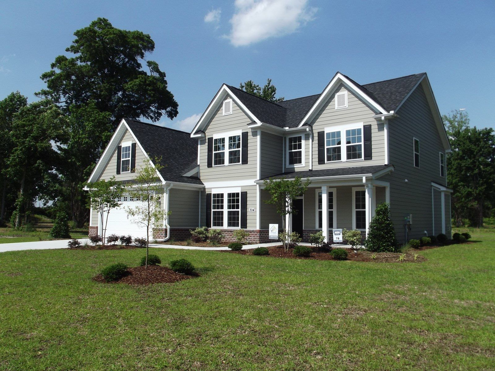 THE KENT 3 CAR GARAGE PLAN By H Homes at Towne Pointe