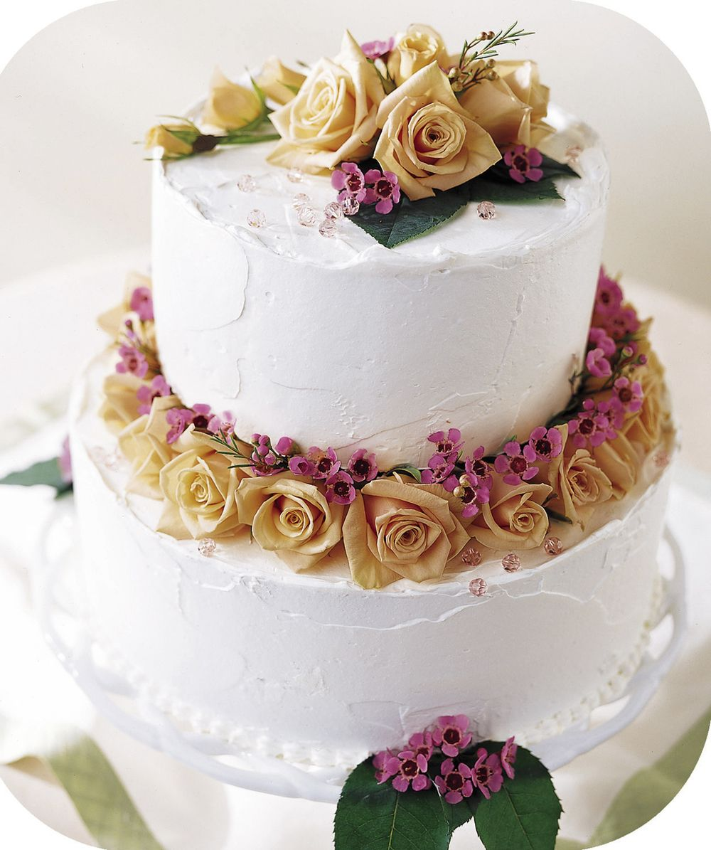 Stunning and unique, 2 tier cake with floral decoration by