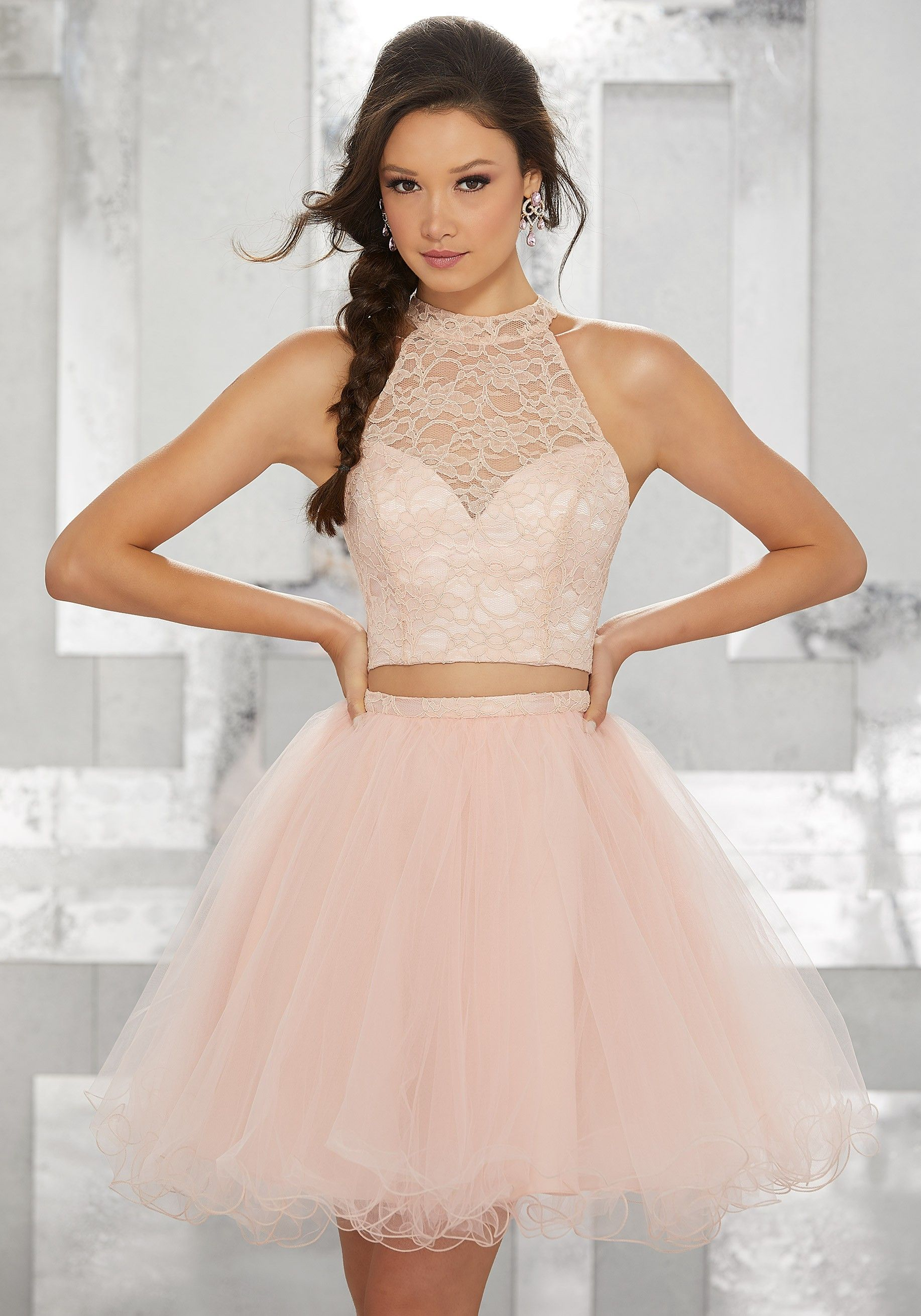 This femine two piece features a crop top with a sweetheart neckline with a  halter lace overlay. The full tull skirt is completed with ... b16697e48fe5