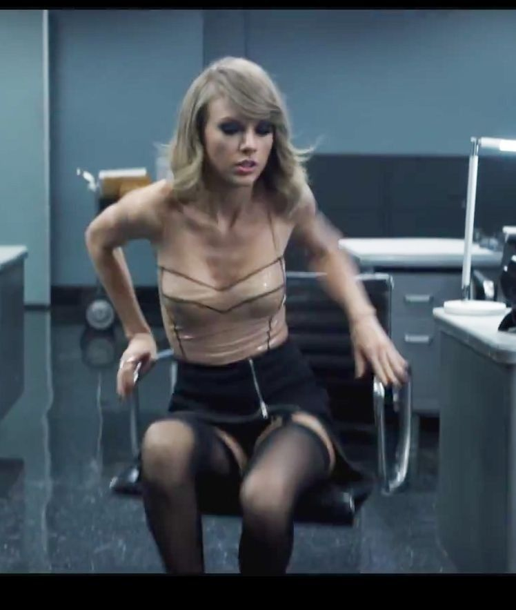 671e961a598 Taylor Swift sexy outfit with sheer black thigh high stockings and heels