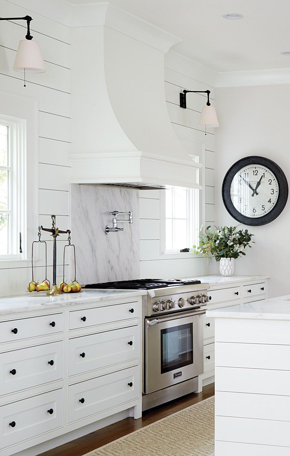 Antique white kitchen cabinets are used so that the ...