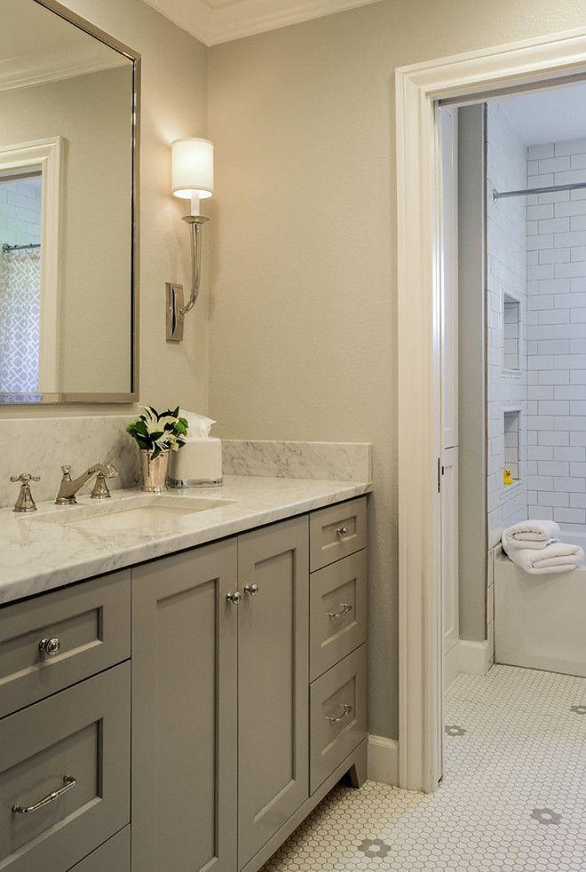 Grey Bathroom Grey Bathroom With Pale Grey Walls And Grey Cabinets Grey Grey Bathrooms Grey Bathroom Cabinets Traditional Bathroom