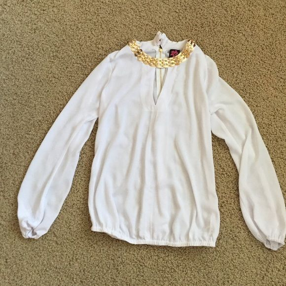BEBE sheer white dressy top! Chic sheer white long sleeved top! Ready for a night out with gold chain design around neck and v cut in front! bebe Tops
