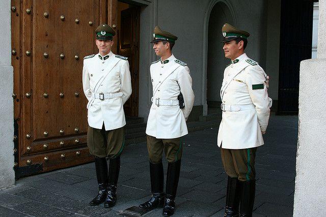 Chilean Police guardsmen (Guardia de Palacio de Carabineros de Chile) in white summer uniforms at the Palacio de La Moneda in Santiago, Chile.
