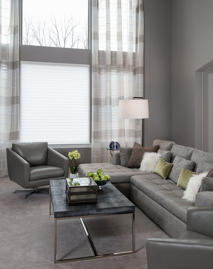 Monochromatic gray living room, clean lines with pops of green