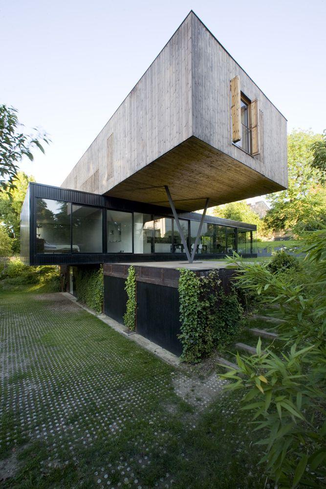 Minimalist House // geometric cantilever wood forms at the House In Sèvres / Colboc Franzen & Associés