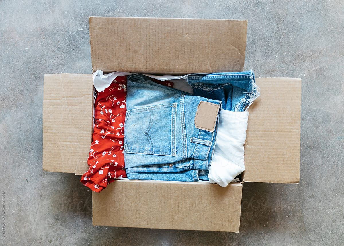 Vintage Clothing Packed In Cardboard Box On Floor For