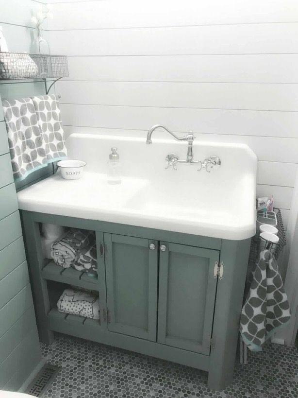 Photo of Farmhouse drain board sink with custom bathroom cabinet