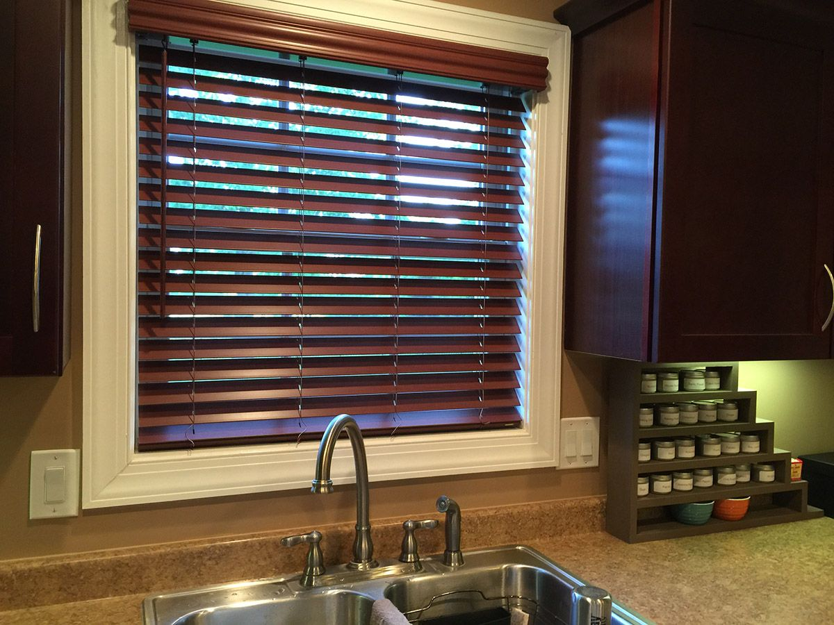 Graber lake forest faux wood blinds are a great touch for