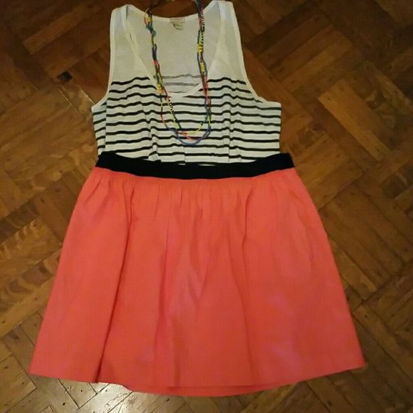 Color Block Skirt Coral colored skirt with thick blue elastic waistband. Skirt has two pockets and hits just above the knee. Tag says the skirt is 100% cotton but the material has more of a soft crinkle feel to it.   Never worn and still has all original tags. :) J.Crew Factory Skirts