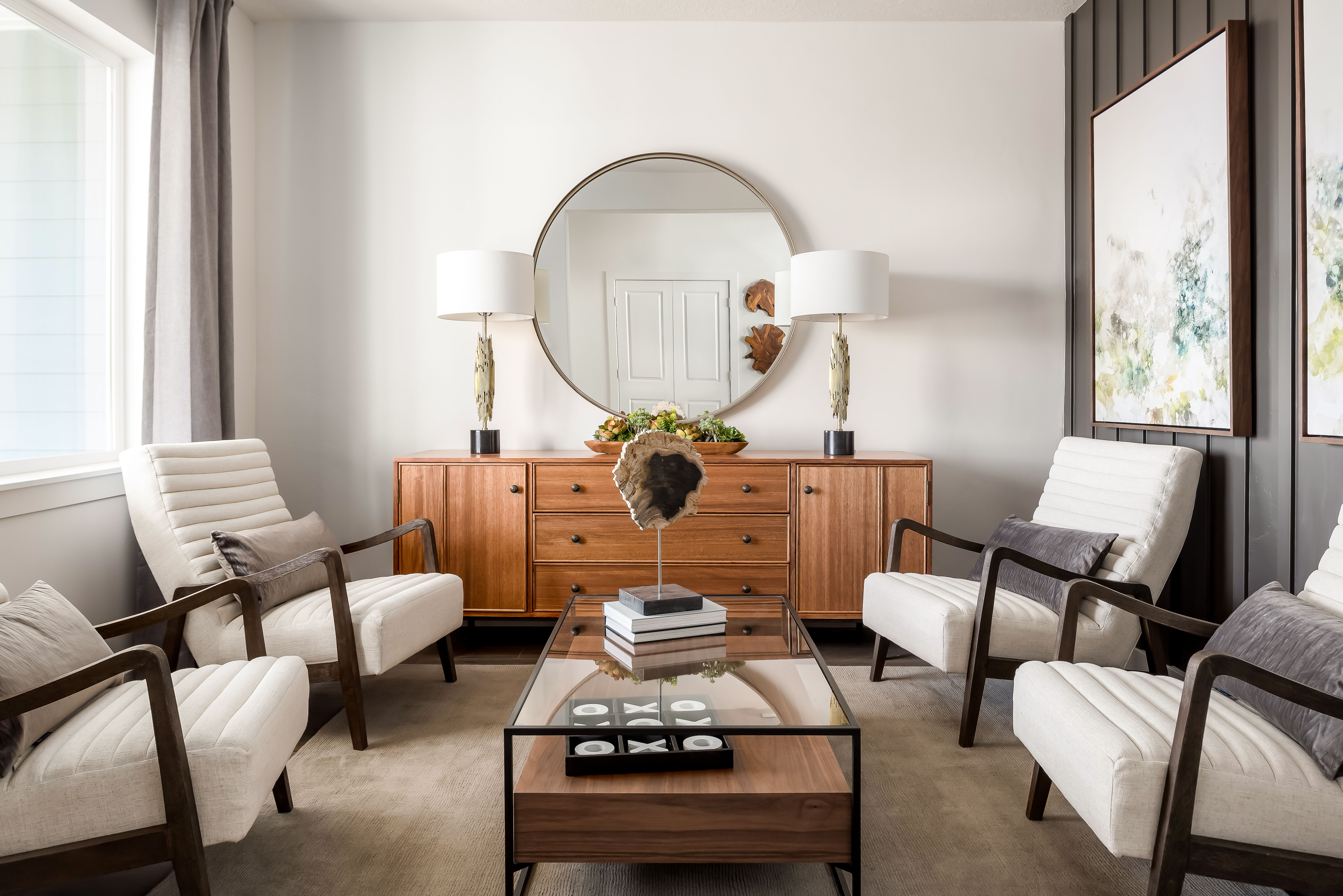 The Circular Mirror And Stunning Furniture Elevate The Look And
