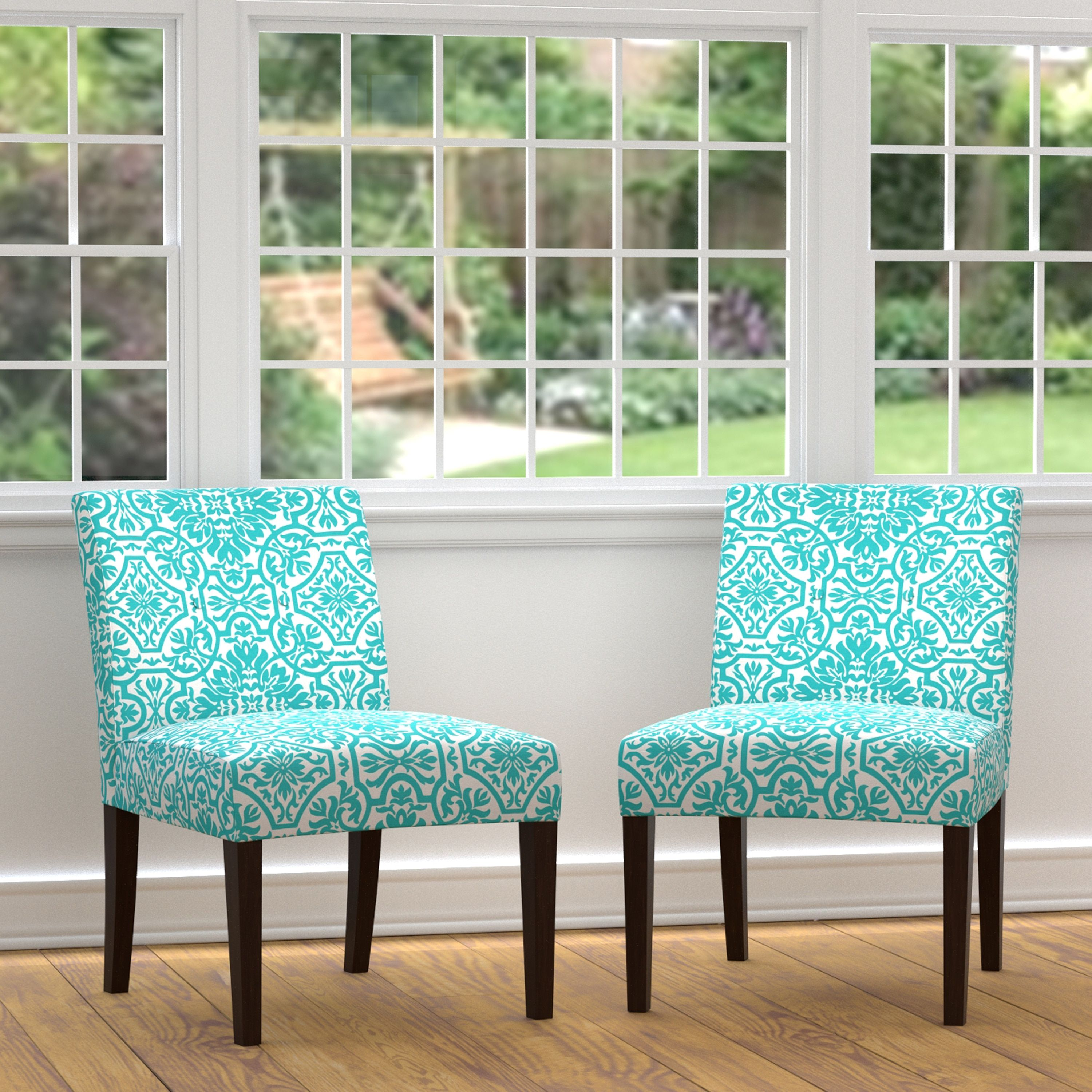 turquoise living room chairs create an inviting atmosphere with