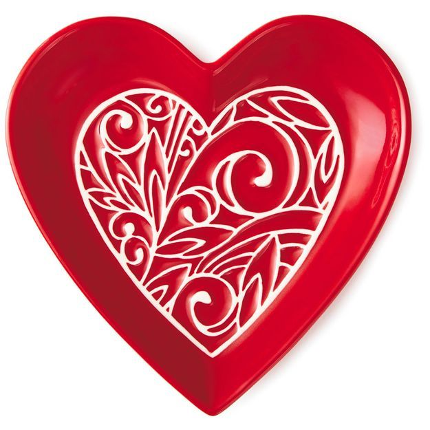 Our red, heart-shaped ceramic dish with an embossed pattern in ...
