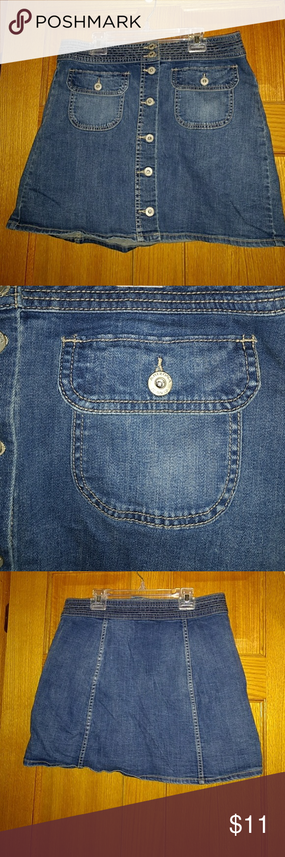"Arizona button denim skirt size 13 Size 13  Arizona brand Denim skirt Denim is stretchy  About 16"" across at waist About 23.5"" across at bottom 16"" tall Worn several times, like new Arizona Jean Company Skirts Mini"