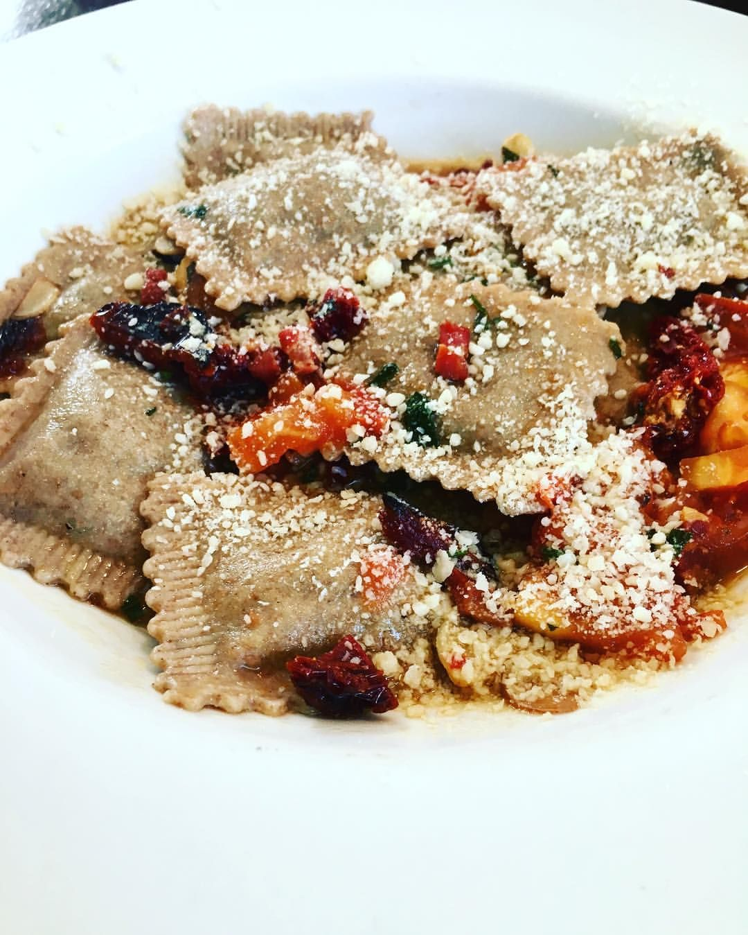 """Stopped at """"PastAmore"""" in Amherst NH on our way back home from our road trip. I got the Ravioli Montanara.  pinach & Ricotta multi-grain ravioli with pancetta, cherry tomatoes, onions, sun dried tomatoes & garlic in a white wine sauce. #pastamore #ravioli #italian #girlsweekend #roadtip"""