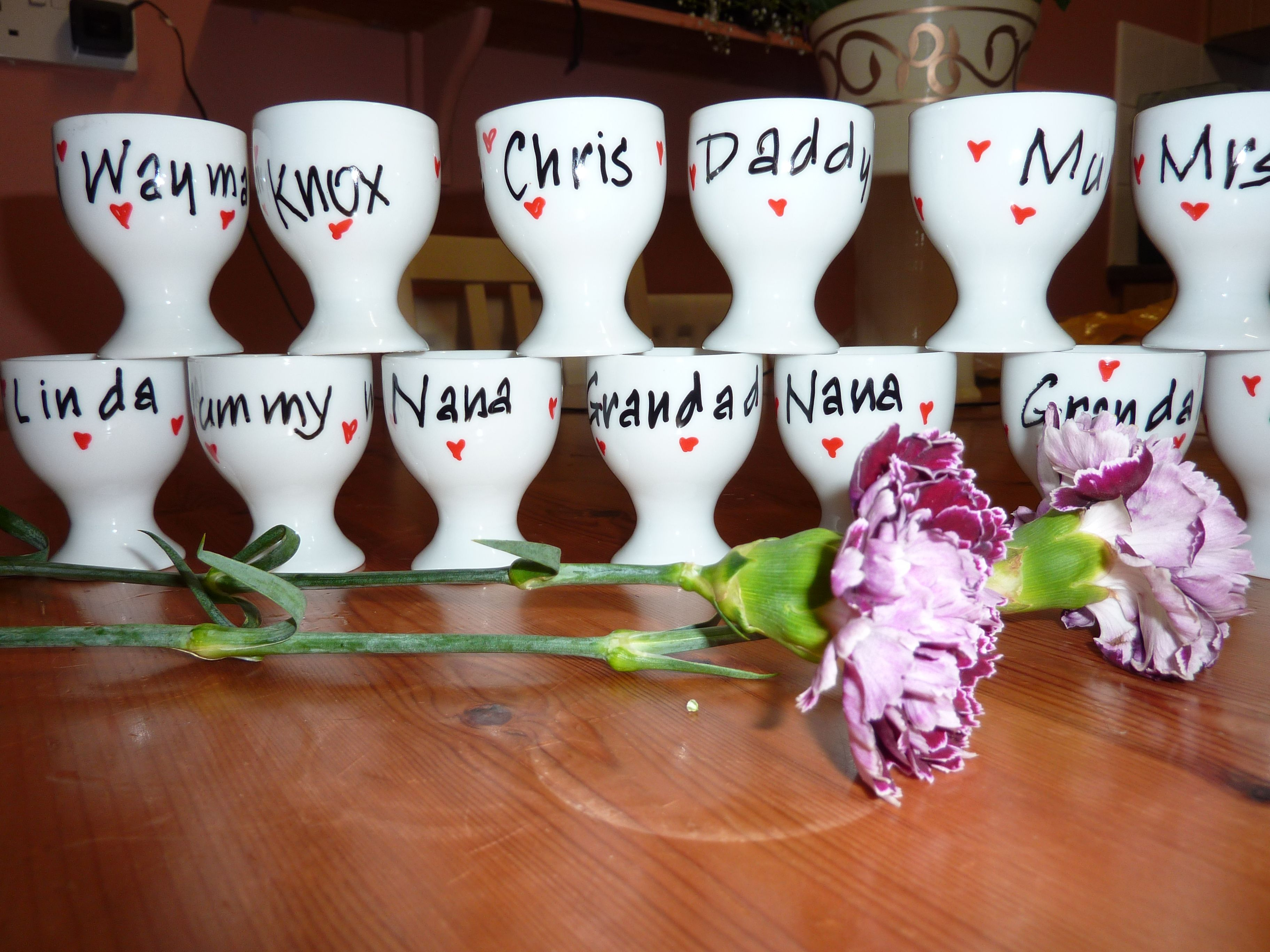 Ceramic Personalised Heart Egg Cups Made As Joint Place Cards And Wedding Favours