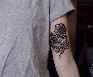 b+w sunflower upper arm tattoo