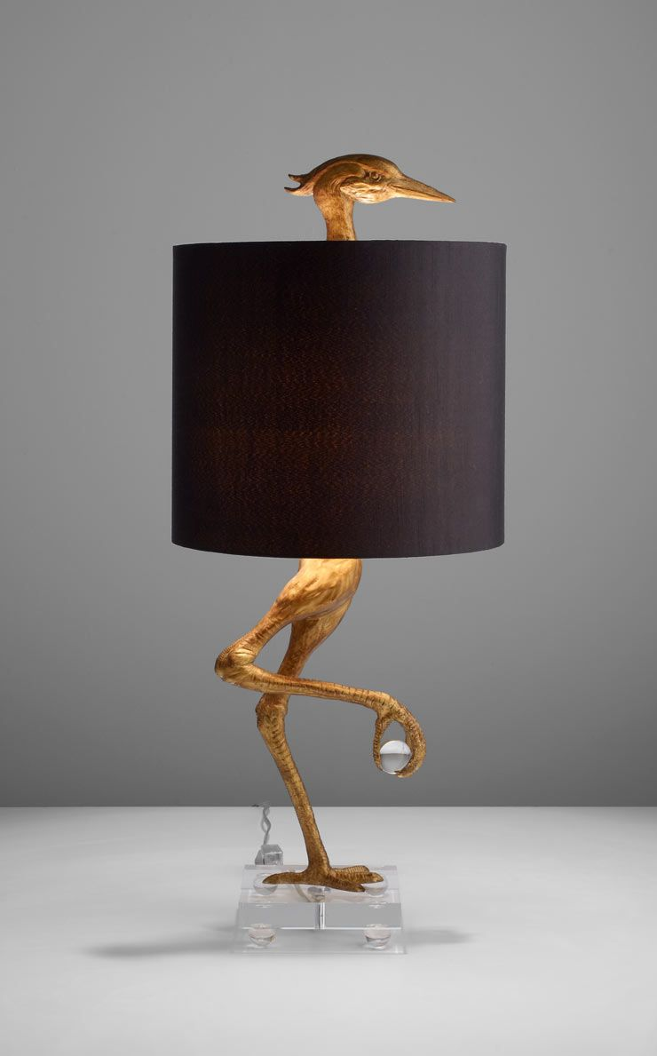 What a fun unexpected lamp ibis table lamp by cyan design a golden bird shaped base anchors this transitional table lamp with his head peering from the top of its black satin shade bird shape table lamp with gold mozeypictures Choice Image