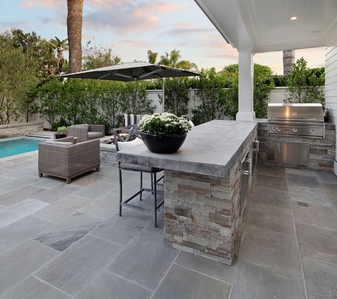 outdoor kitchen the outdoor kitchen features concrete countertop and stone these pavers are a on outdoor kitchen natural id=58949