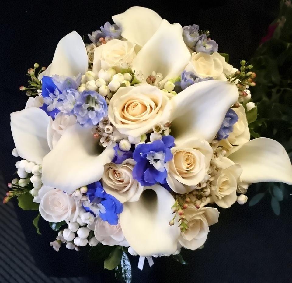 Bridal bouquet featuring roses, calla lilies, bouvardia ...
