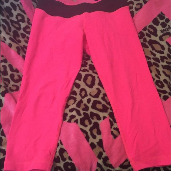 Lululemon Wunder Under Crop 8 Hot pink lululemon Wunder under crops. Reversible and size 8. A lot of pilling in the crotch area. Less pilling on side with black waist. Also pilling throughout entire back side of all pink side. Comes from a smoke free home. lululemon athletica Pants Capris