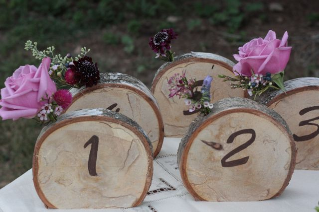 Love, love, love the flowers sticking out of each wooden table number! :: Photo by Holly Chapple Flowers