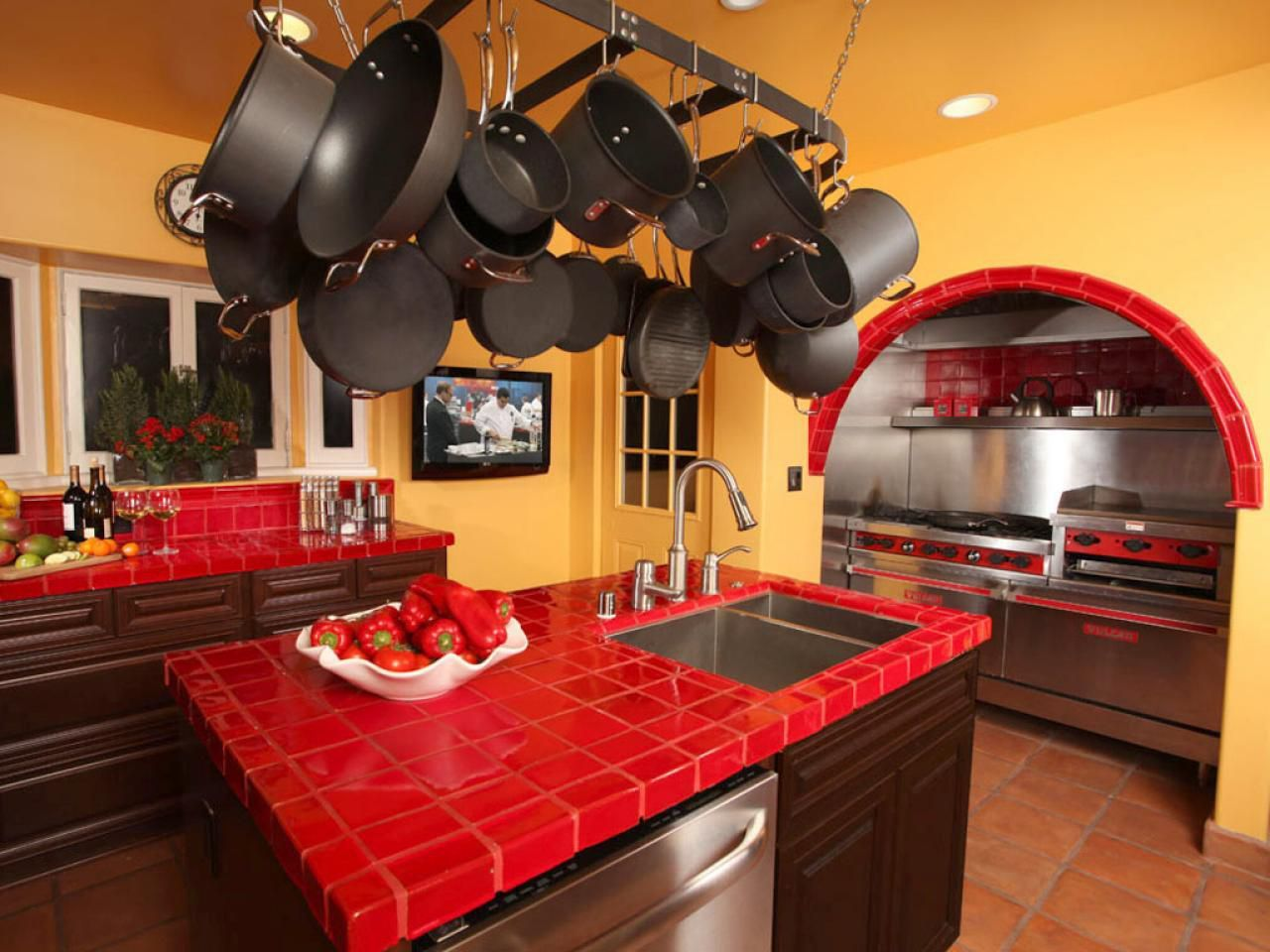 Mexican Kitchen Designed With Orange Wall Colors And Red Ceramic Tile  Countertops With Brown Cabinets :