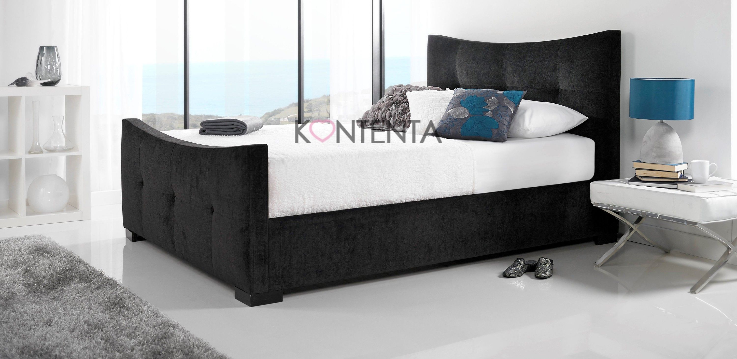 The kaydian seaton bed frame is upholstered in a stylish black fabric made from 85 polyester 15 viscose fabric with a gentle curve design for the head