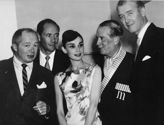 Billy Wilder, Mel Ferrer, Audrey Hepburn, Maurice Chevalier & James Stewart at Ciro's nightclub, West Hollywood, 1956.