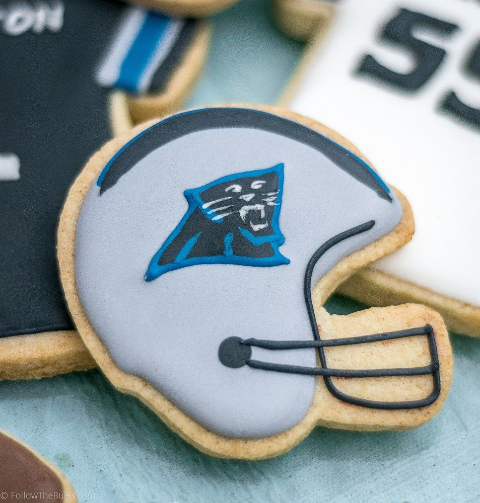 Cookies designed like Carolina Panthers' helmets and jerseys. Perfect for your Super Bowl watch party!