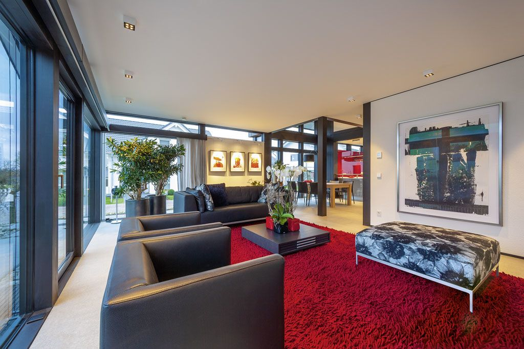 wohnzimmer mit bodentiefen fenster und viel glas im huf haus modum 8 10 fachwerk von huf haus. Black Bedroom Furniture Sets. Home Design Ideas