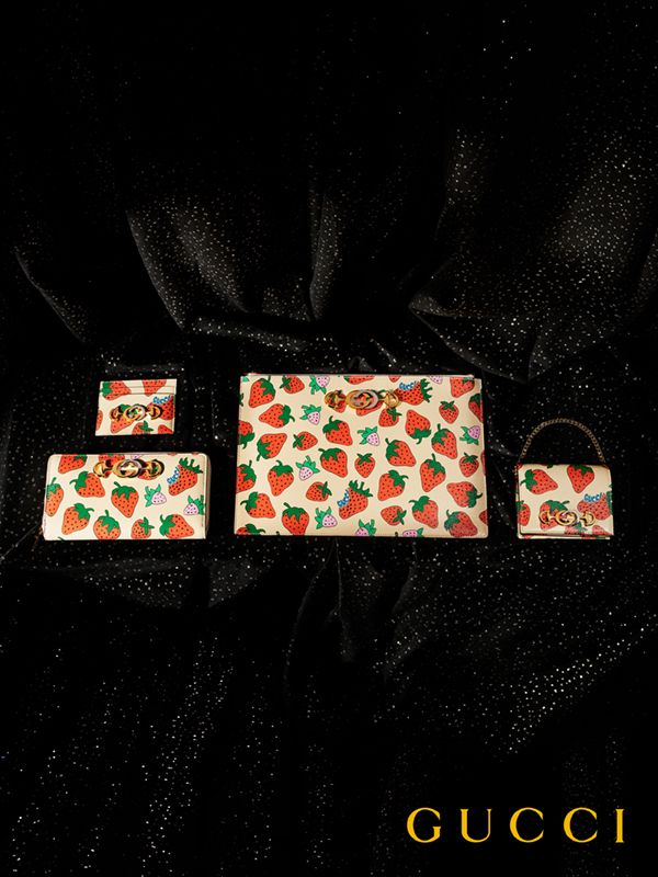f5f9e4b7022 A lineup of Gucci Zumi bags and small leather accessories embellished with  a strawberry print.