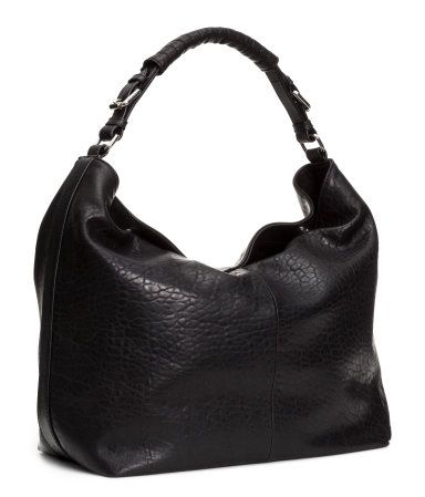 75ddc06a83 Hobo bag in leather with a short shoulder strap and magnetic fastener at  the top
