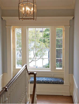 Nooks and crannies window seat at the top of stairs. Trim ...