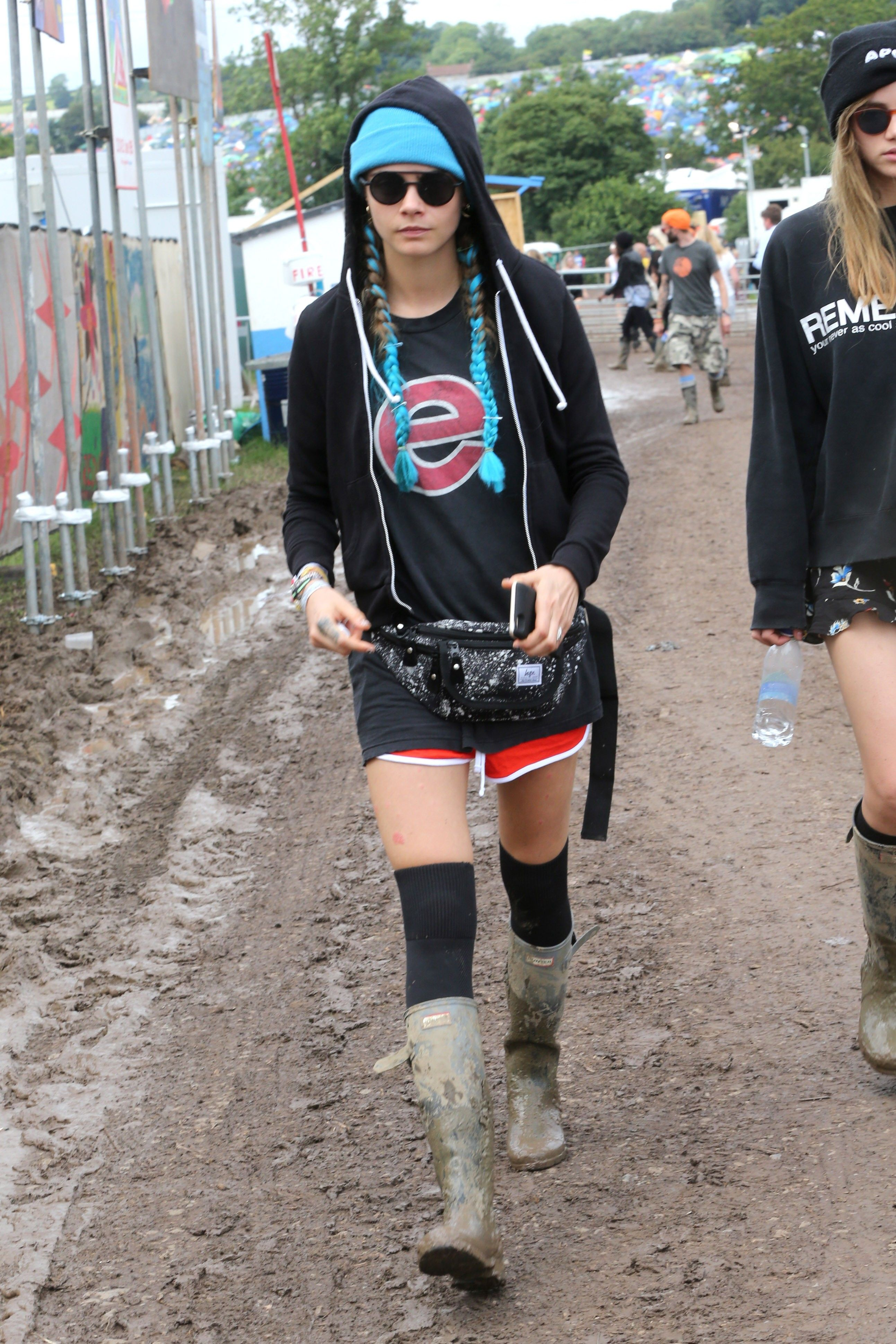 ... black hoodie, black short shorts, thigh high socks and Hunter Original  Tall Rain Boots in Black at the 2016 Glastonbury Festival. ac0d730f7a
