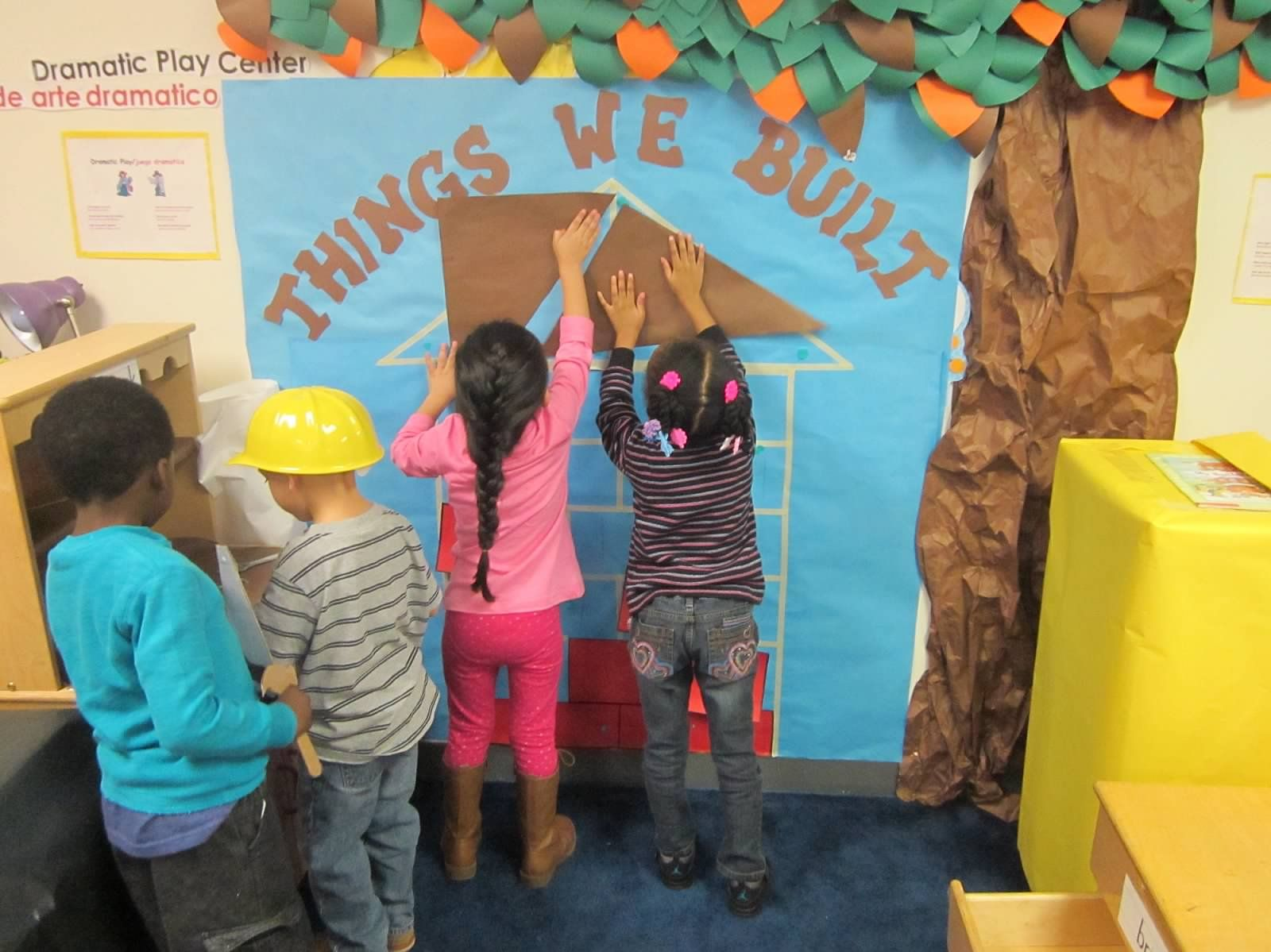Dramatic Play:Things We Build- I made a blueprint of a house with shapes then I gave the students the big cut out shapes to match them on the wall and buld the house. The had so much fun fitting the shapes in.