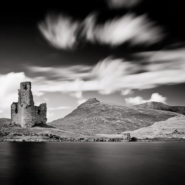 Black and white landscape photo of a castle in scotland