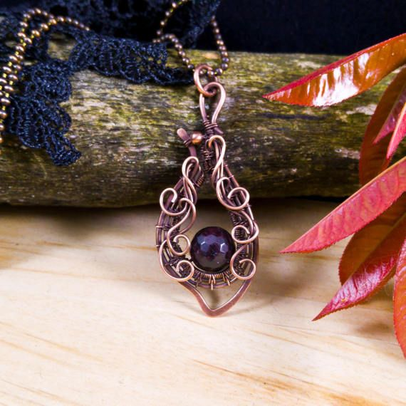 Garnet handmade vintage necklace; wire wrapped antiqued oxidized copper pendant Art Nouveau inspired. Natural gemstone handcrafted jewelry 2 1/4 X 1 inch ( 5.8 X 2.4 cm ) Dark red wine color garnet pendant featuring a natural organic design. Matching earrings: https://www.etsy.com/listing/503691366/garnet-handmade-vintage-earrings-wire