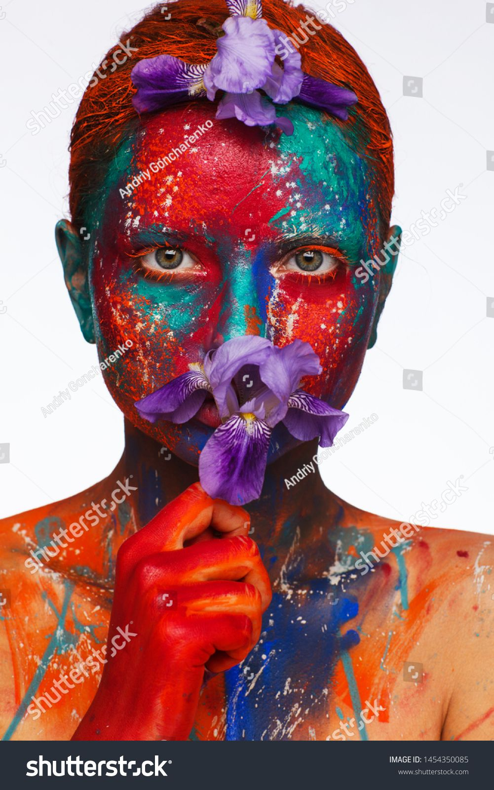 Creative fantastic makeup using colorful paints on the