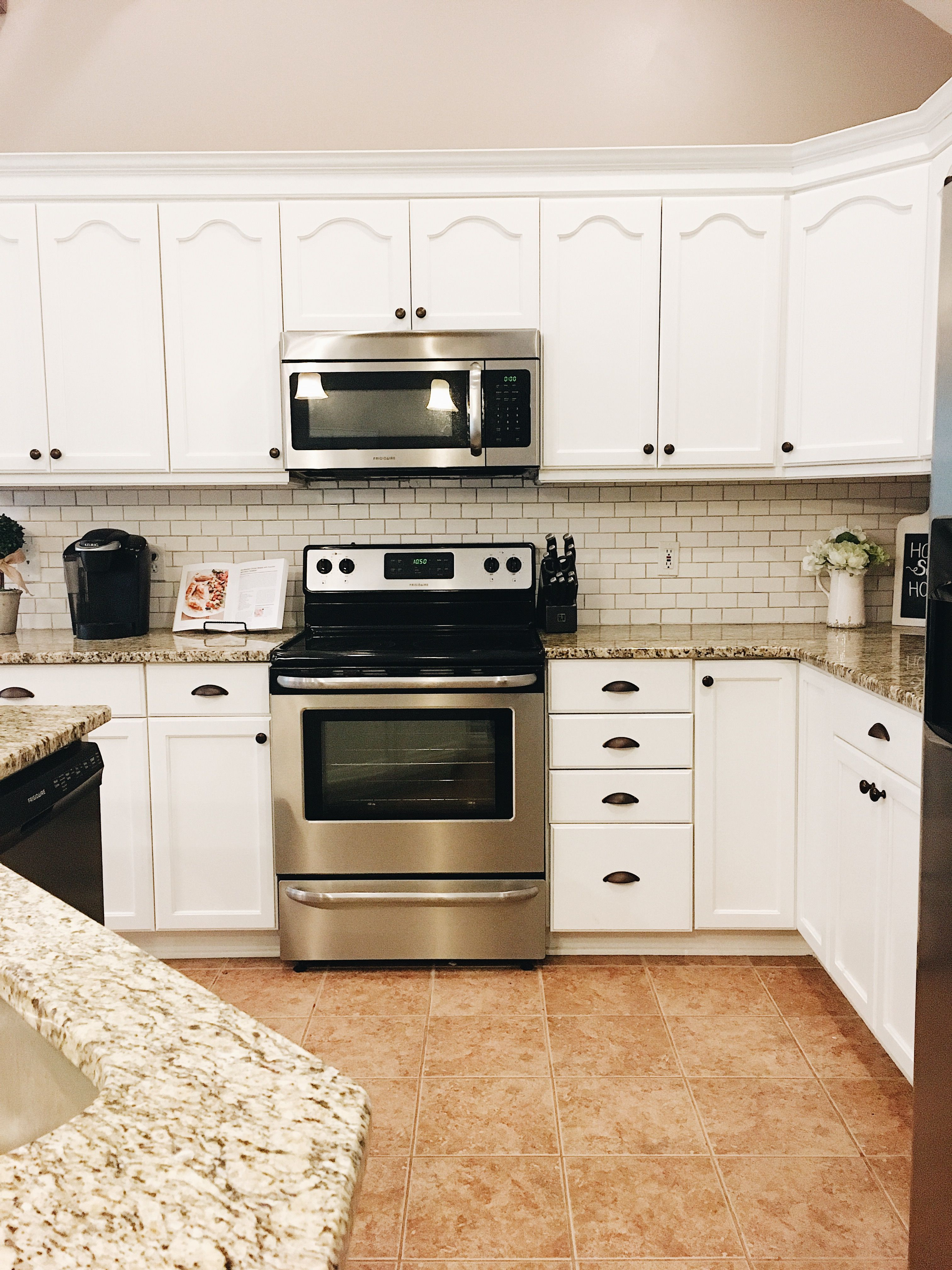 Farmhouse Kitchen Renovation - White Cabinets - Subway Tile -