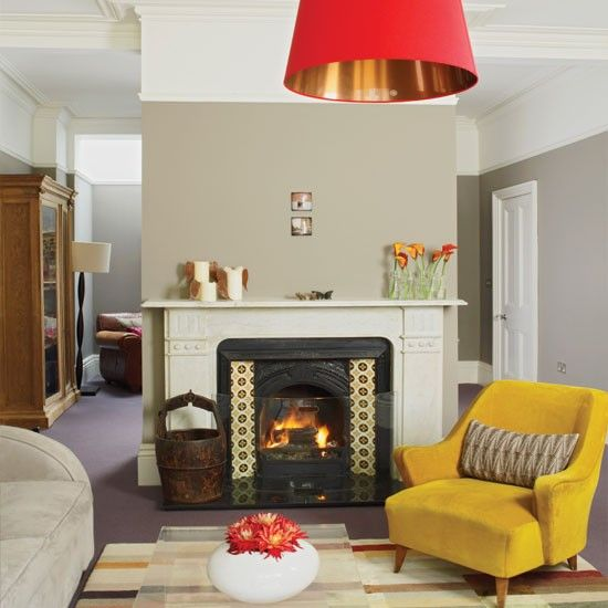 grey walls mustard chair mustard and brown concept fireplace cosy living roomsliving