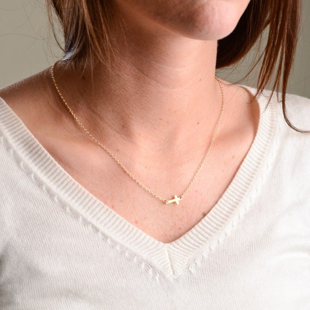 Freshie and Zero Simple Tiny Horizon Cross Necklace- With the Tiny Horizon Cross necklace by Freshie and Zero, remember that even the tiniest bit of faith can bring us through the biggest problems. Whether you're in a time of praying or praising, remember faith.