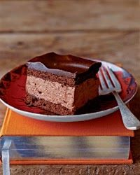 Chocolate Cream Squares | This super-rich dessert contains chocolate whipped cream between layers of bittersweet chocolate cake topped with a fudgy chocolate glaze.
